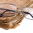 Old book with glasses macro — Stock Photo
