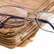 Royalty-Free Stock Photo: Old book with glasses macro