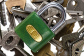 Padlock with key on white — Stock Photo