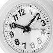 Clock on white close up — Stock Photo