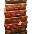 Pile of battered old suitcases - Stock Photo