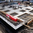 Construction of concrete foundation of building - Zdjcie stockowe