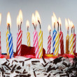 A birthday cake with lighted candles — Stock Photo
