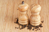Salt and pepper grinders on a table — Stock Photo