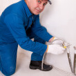 Plumber fixing water pipe — Stock Photo #5604178