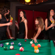 Group of happy girls playing in billiard - Stock Photo