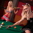 Happy girls playing in billiard — Stock Photo #5761970