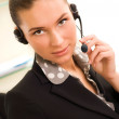 Young business woman wearing headphones — Stock Photo