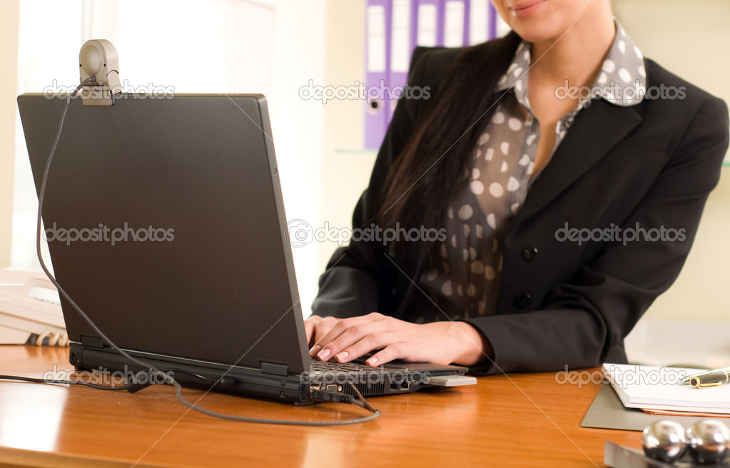 Business woman sitting in the office in front of the laptop — Stock Photo #5761996
