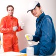 Construction workers at work, preparing to paint — Foto Stock