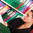 Business woman filling files in the  folders — Stock Photo