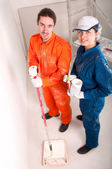 Construction workers at work, preparing to paint — Stock Photo