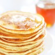 Pancakes with honey - Stock Photo