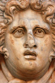 Escultura de cara en la antigua ciudad de leptis magna libia — Foto de Stock