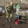 Man and a cultivator - Stockfoto