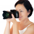 Stock Photo: Young womwith DSLR