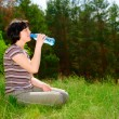 Girl with a water bottle — Stock Photo