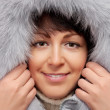 Portrait of young woman in fluffy hood — Stock Photo