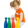 Little funny girl with toys — Stock Photo