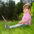 Little girl with laptop — Stock Photo