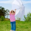 Little girl with parasol — 图库照片