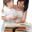 Little girl and her mother with books — Stock Photo #5791217