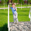 Little girl in a park — Stock Photo