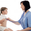 Doctor listens by stethoscope girl — Stock Photo