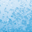 Stock Photo: Light blue frozen window glass
