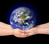 Child and woman holds earth globe — Stock Photo