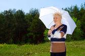 Senior woman with parasol — Stock Photo