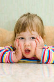 Ridiculous thinking little girl — Stock Photo