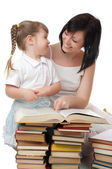 Little girl and her mother with books — Stock Photo