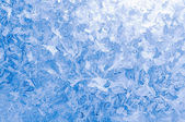 Light blue frozen window glass — Stock Photo