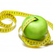 Stock Photo: Apple with centimeter tape