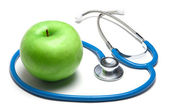 Green apple with stethoscope — Stock Photo