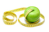 Apple with centimeter tape — Stock Photo