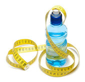 Blue bottle of water with centimeter tape — Stock Photo
