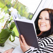 Woman reading book in house — Stock Photo #5413370
