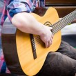 Musician playing guitar on city street - Stock Photo