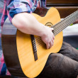 Stock Photo: Musiciplaying guitar on city street