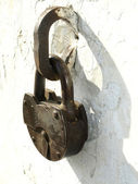 Old locks on a white background of an old wall — Stock Photo