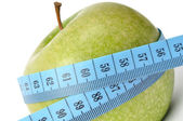 Apple and measuring tape — Stockfoto