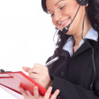 Call center woman with a headset - Stock Photo