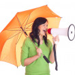 Girl with megaphone and umbrella — Stock Photo