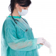 Royalty-Free Stock Photo: Doctor pulling on surgical gloves