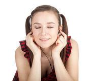 Smiling girl in headphones — Stock Photo