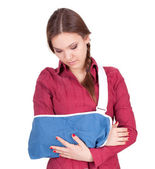 Young woman in arm sling — Stock Photo