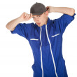 Young man in blue coveralls — Stock Photo