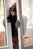 Male thief in mask and hood — Stock Photo